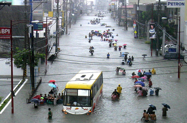 Commuters in Manila wade waist-high down a thoroughfare. Ketsana is thought to have triggered the worst flooding in the Philippine capital in over four decades