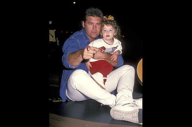Cyrus, age two in this photo, is the daughter of country singer Billy Ray Cyrus, who is probably best known for the hit,