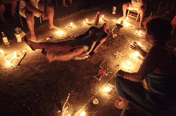 In this candle ceremony, known as the velaci�n, the patient lies on an oracolo, a drawing of esoteric symbols made on the ground with talcum, surrounded by candles and fruit, and is showered with flower petals meant to impart energy