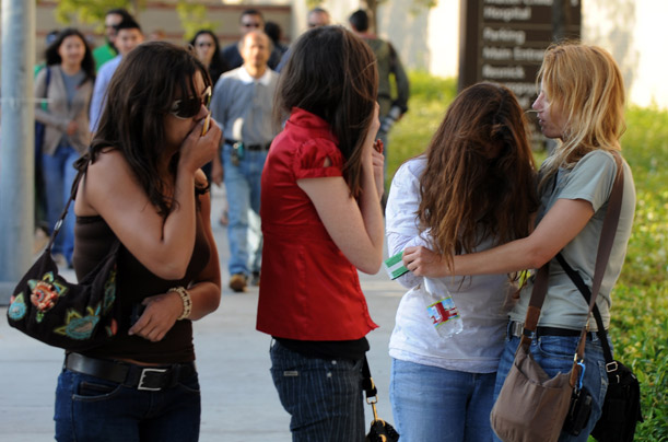 Fans weep and console each other outside the UCLA Medical Center. Hundreds gathered once news spread that Michael Jackson had been pronounced dead on Thursday.