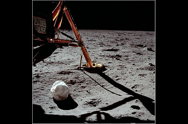 This frame was the very first photo he shot after setting foot on the lunar surface. It shows the lunar module strut and the jettison bag, which was used to hold empty food containers and other unwanted items.