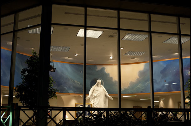 The visitors' center at the Oakland, Calif., LDS church features a statue of Christ surrounded by a mural.