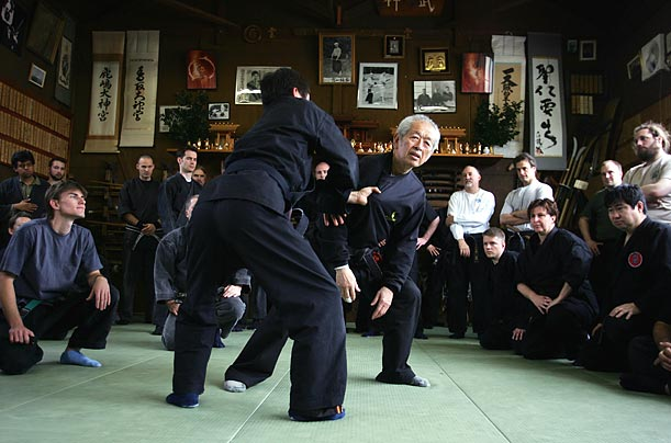 Perhaps the last living master of ninjitsu, Grand Master Masaaki Hatsumi demonstrates a technique during a lesson at the Bujinkan Dojo,