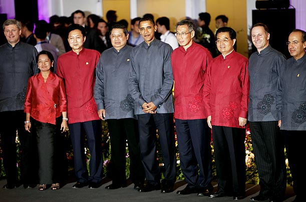 President Barack Obama, center, stands with other APEC leaders for a group photograph following their evening dinner in Singapore.