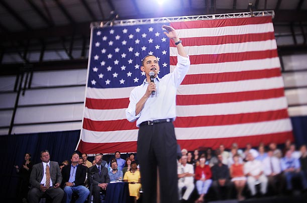 Obama speaks at a town-hall meeting in a hangar at Gallatin Field Airport in Belgrade, Mont.