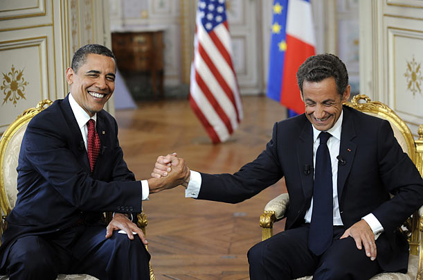 President Barack Obama (L) shakes hands with France's President Nicolas Sarkozy during a bilateral meeting at the Prefecture of Caen June 6, 2009.