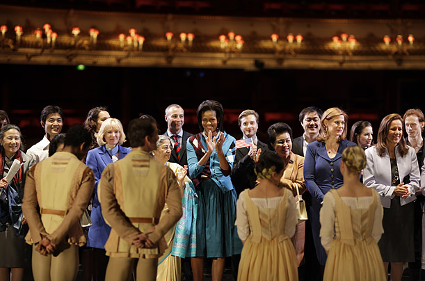 First Lady Michelle Obama applauds for dancers after a private performance at the Royal Opera House in London.