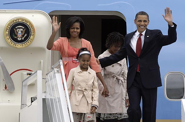 President Barack Obama, his daughters Malia and Sasha and his wife Michelle depart Air Force One at Moscow's Vnukovo Airport.