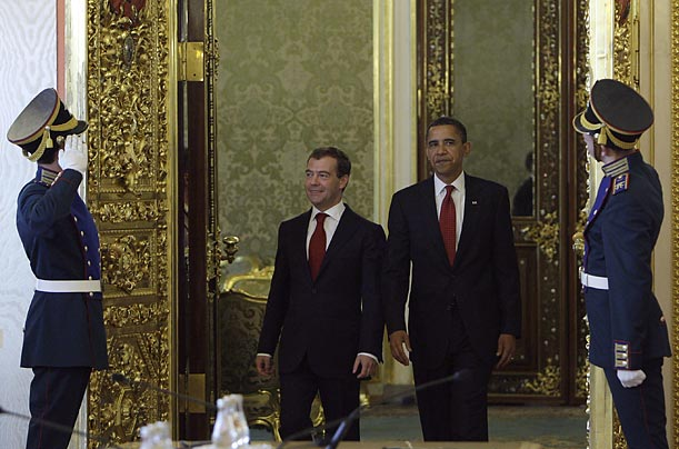 Medvedev, left, and Obama arrive together for a meeting.