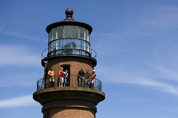 President Barack Obama and his family and friends tour Gay Head lighthouse in Aquinnah on Martha's Vineyard. The lighthouse first began operating in 1799.