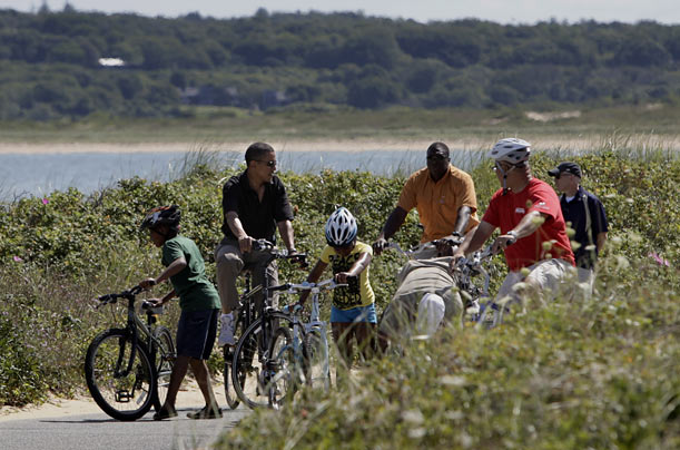 The President rides bikes with family and friends along Lobsterville Beach in Aquinnah.