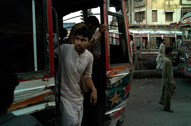 A man disembarks a bus at a junction in Karachi. Though much of Pakistan remains peaceful and moderate, extremist groups have increased their influence on its politics, stability and daily life.