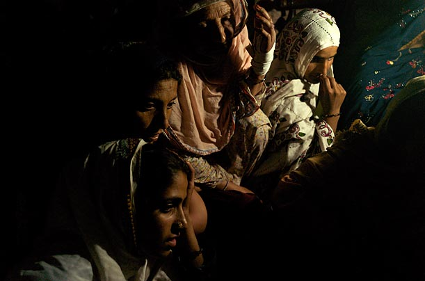 Pashtun women, forced from their homes by the fighting in the north, attend an all-female assembly at Chak Shazhad village.