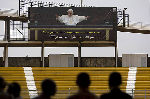 A billboard of Pope Benedict XVI towers over a stadium where Cameroonians are preparing for the pope's coming visit, in Yaounde, Cameroon, S