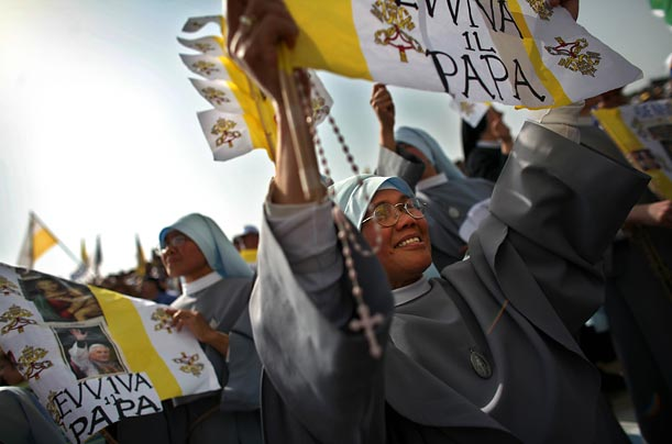 Tens of thousands of pilgrims throng to the beat of drums and tambourines during  Benedict's largest Holy Land mass.