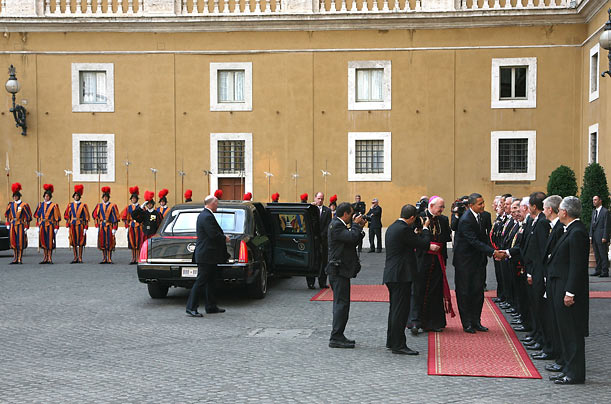 Obama is greeted by the Papal Gentlemen, the Pope's attendants, before meeting with the Holy Father.