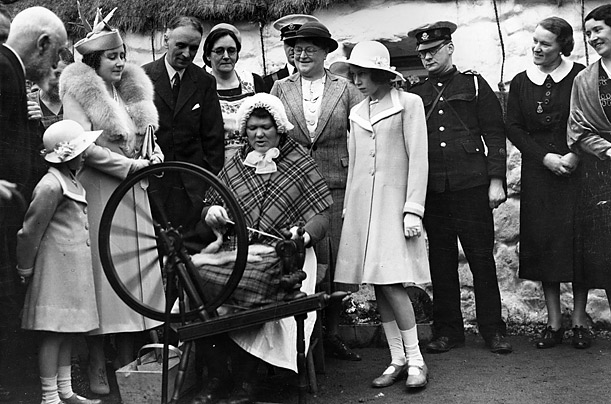 Queen Elizabeth has been the focus of contrived photo ops since she was a young girl. Here the young Elizabeth, not yet Queen, watches a traditional spinner at work in a Scottish Highland village in 1938