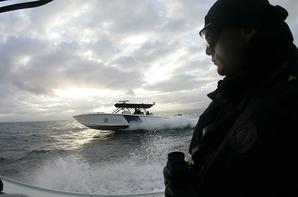 US. Customs and Border Protection agents patrol the coastline bordering San Diego, California and Tijuana, Mexico for illegal activity in the early morning hours from 4:30am until 8:00am.