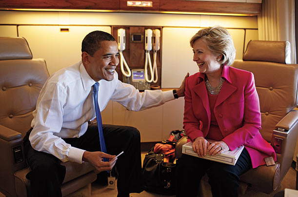 The President and Secretary of State Hillary Clinton confer on Air Force One in April as they head for Strasbourg, France, where the President gave a speech.