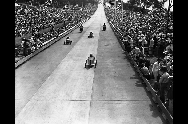 Contestants in the 1936 All-American soapbox derby roll across the finish line in Akron, Ohio. The brainchild of Dayton Daily News