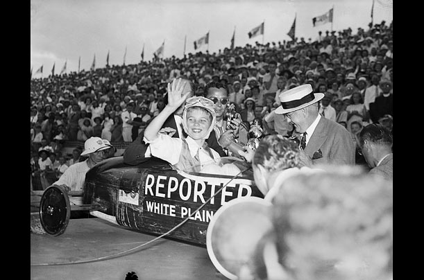 Clifford Hardesty of White Plains, New York waves from his car, after winning 1939 Derby, in which there were 114 entrants. More than 500 will compete this year.