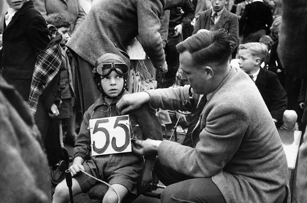 A Father prepares his son for a race in Leighton Buzzard, 1952.