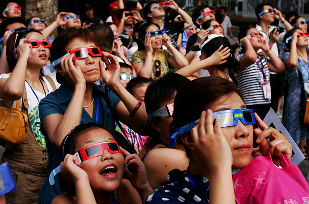 Crowds in China's Hubei province donned special eyewear to avoid retinal damage while staring at the sun