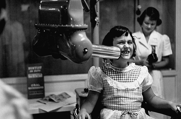 A dental x-ray machine is demonstrated at an exhibit presented by the California dental association in 1953.