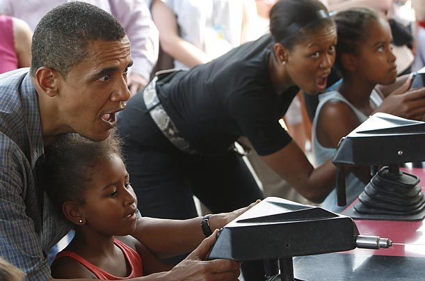 The Obamas and their children try their hand at a game booth at a campaign stop at the state fair near Des Moines in 2007.