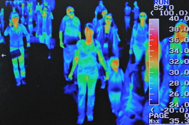 A thermal scanner installed in Incheon Airport in Seoul displays the body temperatures of passengers arriving on an international flight.