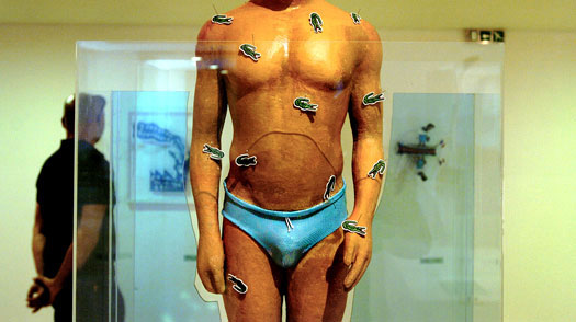 A sculpture of a swimmer covered in logos of French Lacoste clothing company is seen at an exhibition at the Benaki Museum in Athens, Greece, on Thursday, May 18, 2006