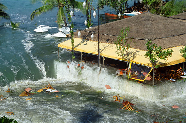 An umbrella covered resort beach as the tidal waves engulf it