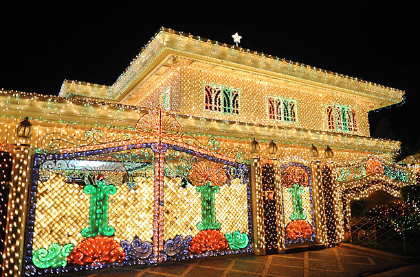 The Dalisay family has wrapped their home in Christmas lights every year since 1996.