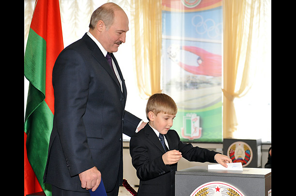 The President watches his six-year-old Nikolay cast a vote. Lukashenko also has two adult sons from another union.
