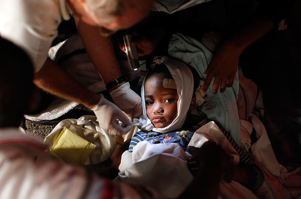 An injured child receives medical treatment in Port-au-Prince.