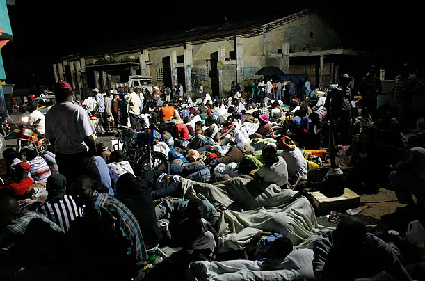 Residents sleep in the street after a 7.0 magnitude earthquake in Port-au-Prince, Haiti