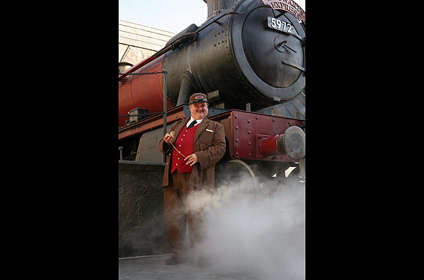 The conductor of the Hogwarts Express welcomes guests. Universal has re-created several of the places featured in the Harry Potter stories, including the shops Dervish and Banges, Honeydukes and Ollivander's Wand Shop.