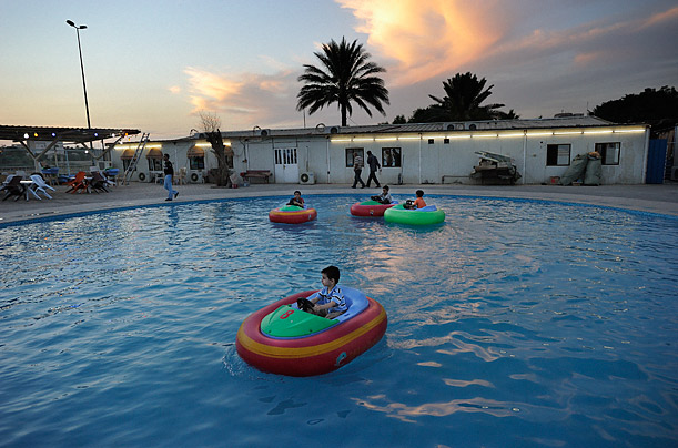 This new pool was built on the banks of the Tigris. On a hot October night, it provides kids with some respite from the heat.