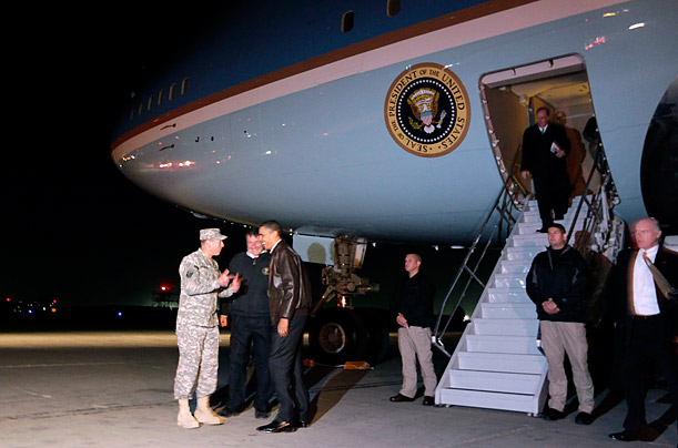 The President steps off Air Force One at Bagram Air Force Base in Afghanistan, where he is greeted by General David Petraeus.