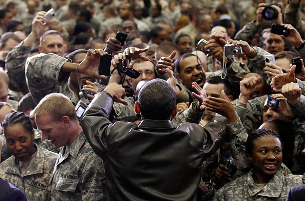 Obama shakes hands with troops after awarding Purple Heart medals to five injured service members.