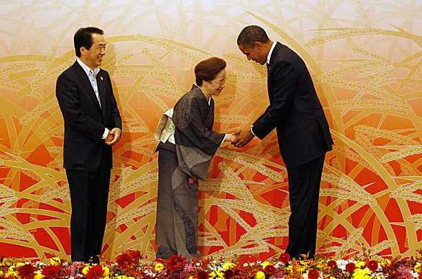 President Obama bows to Nobuko Kan, the wife of Japanese Prime Minister Naoto Kan as he arrives at the APEC Summit in Yokohama.