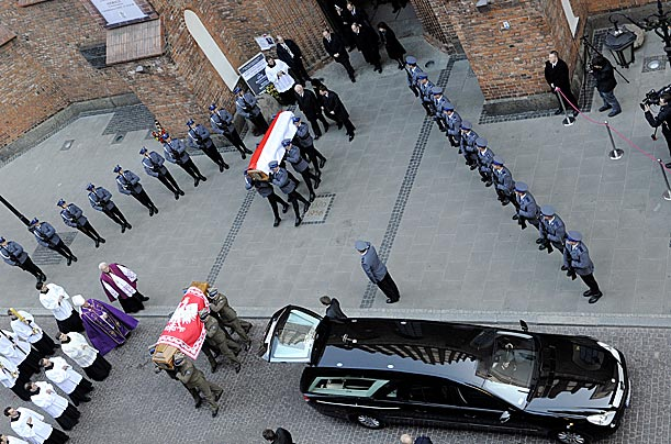 Soldiers carry the coffins of Poland's president Lech Kaczynski and his wife Maria out of St.John's Cathedral in Warsaw.