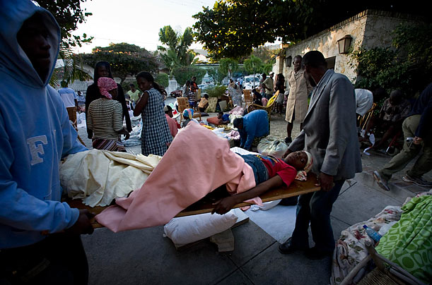 Bodies are pilled up in the street, obstructing traffic, as people start trying to cope with the massive destruction that has devastated Port-au-Prince