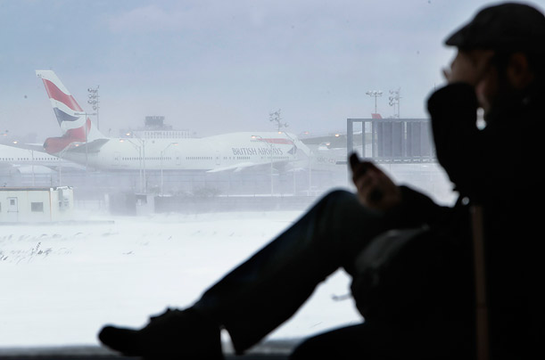 An airplane sits motionless on the runway at John F. Kennedy International Airport.