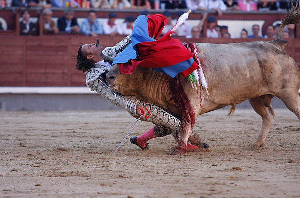 May 21, 2010. Spanish Bullfighter Julio Aparicio is gored in the throat by a bull during a bullfight at the San Isidro Feria at the Plaza de Toro las Ventas bullring in Madrid. The