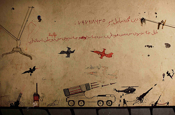 November 10, 2010. Graffiti left behind by Taliban fighters remains on the walls of a compound now used as a command center for the U.S Marine Corps's First Battalion, Eighth Marines at
