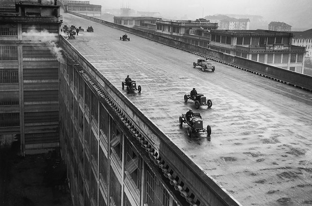 Cars racing around the oval track on the rooftop of the Fiat works in Turin, Northern Italy, built for testing its cars, December 1929