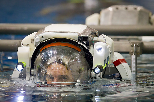 Photographer Smiley N. Pool documents the four astronauts who will ride the last space shuttle as they get ready for their historic mission