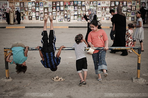 Libyan children play in the women's section of Revolution Square in the rebel stronghold eastern city of Benghazi on July 23, 2011.