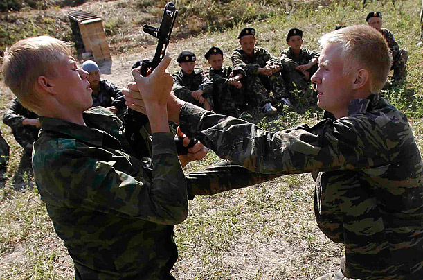 Teenagers undergo training at a military boot camp, run by local Cossack organizations and set up in the mountains of Crimea near the town of Bakhchisarai, Ukraine, August 4, 2011.